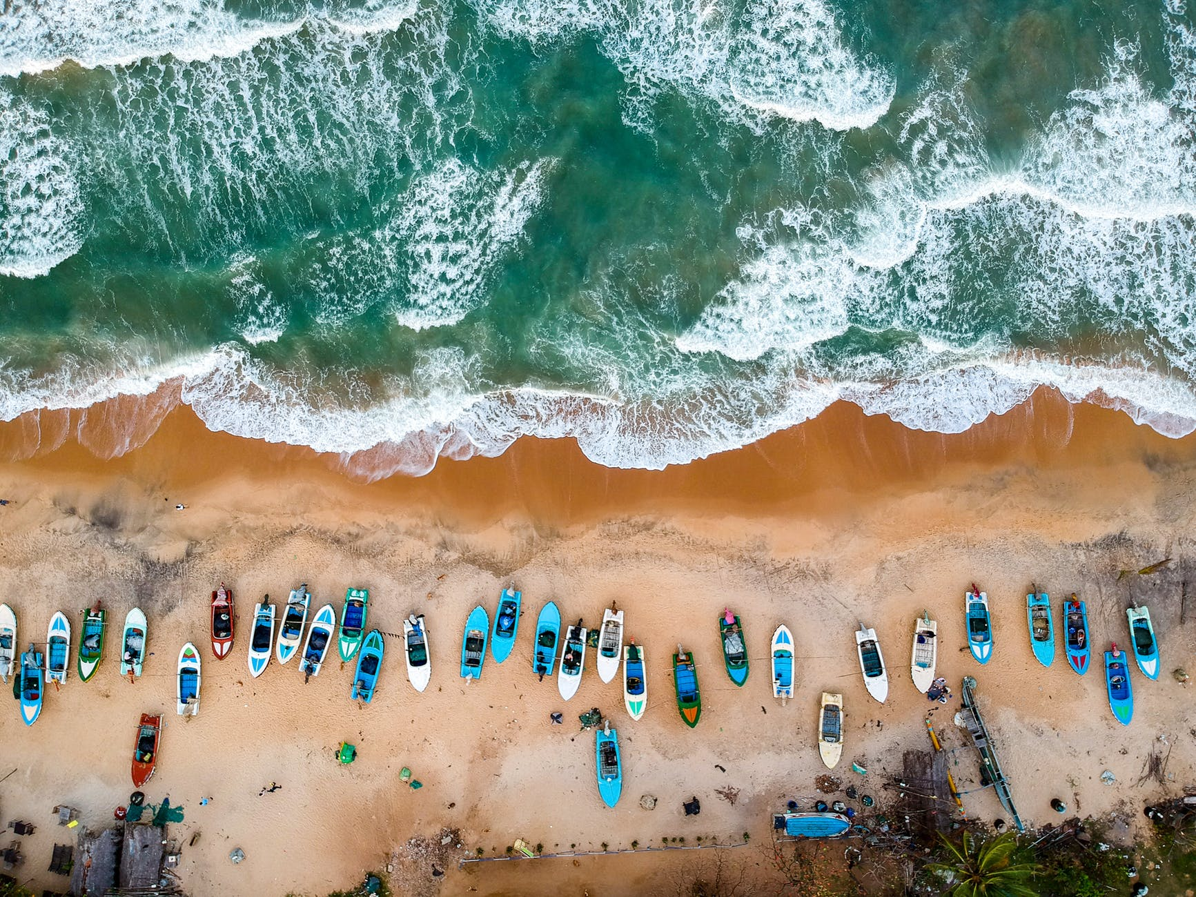 aerial photography of boats on shore